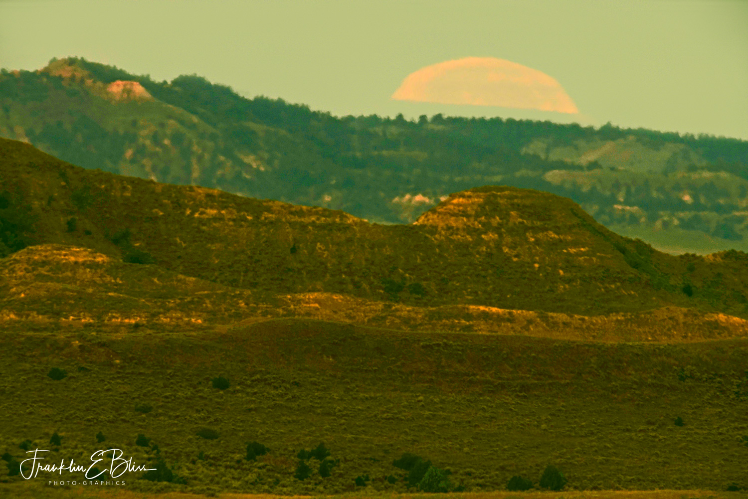 The Harvest Moon Setting Just After Sunrise