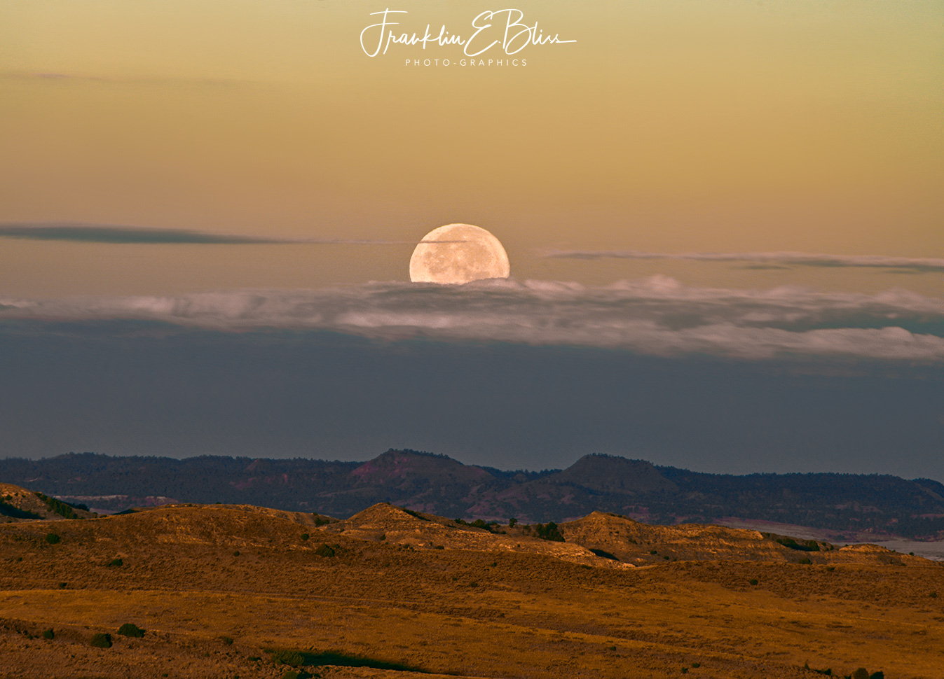 "Full Moon Setting Over the ""Red Hills"" in the Borderlands"