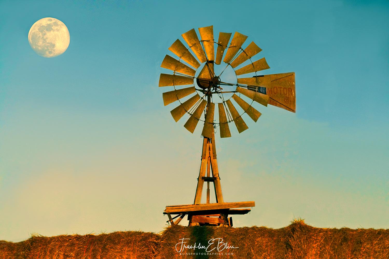 Mooning a Windmill Hiding Behind Hay Bales