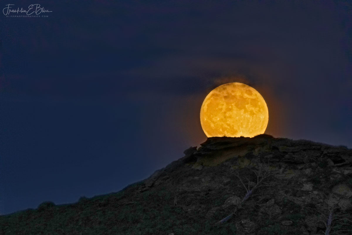 Full Moon Cresting the Butte