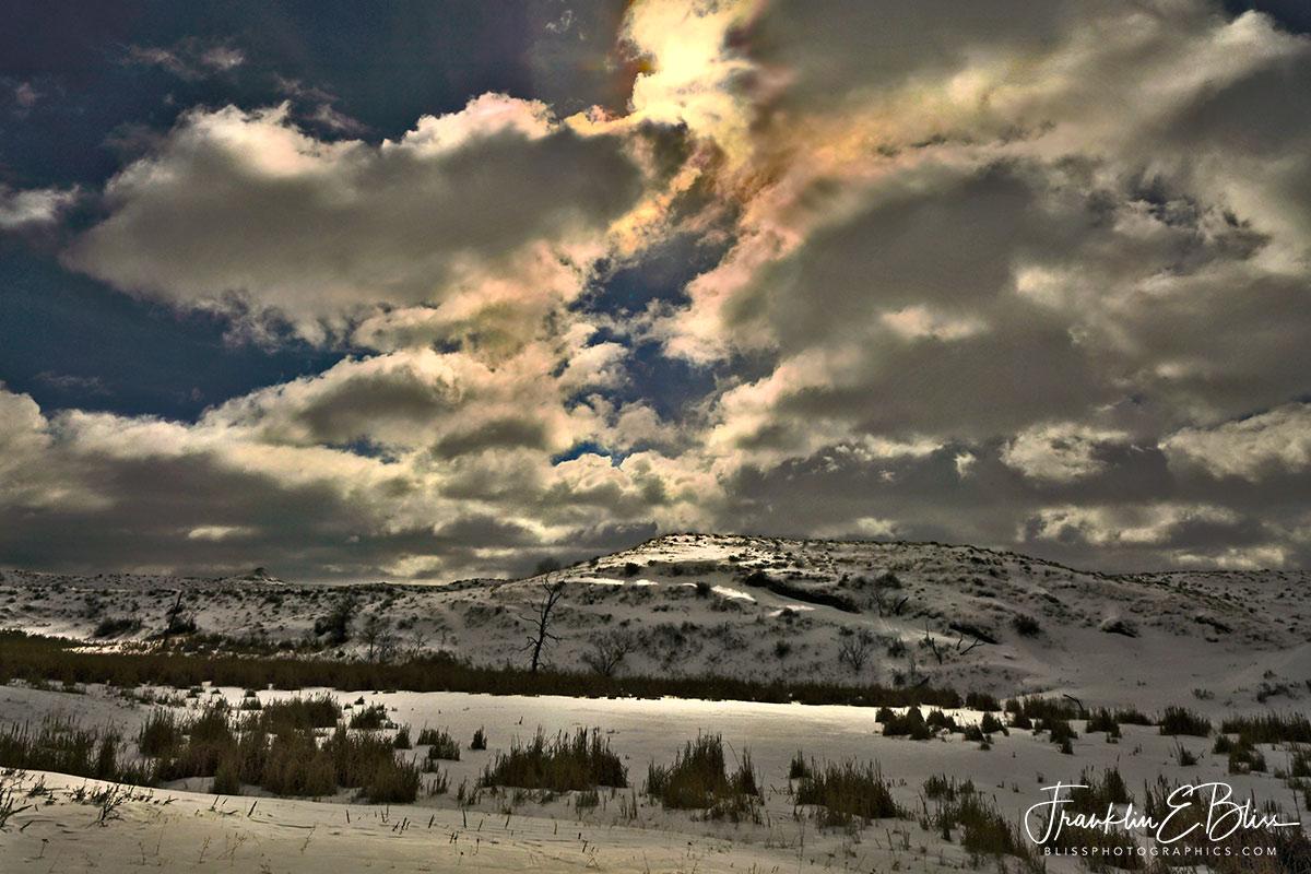 Iridescent Clouds Over Wetlands