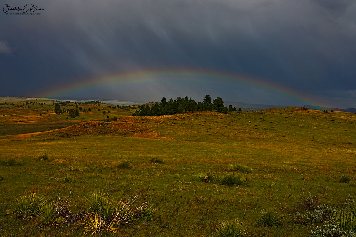 Hail and the Mid-day Rainbow