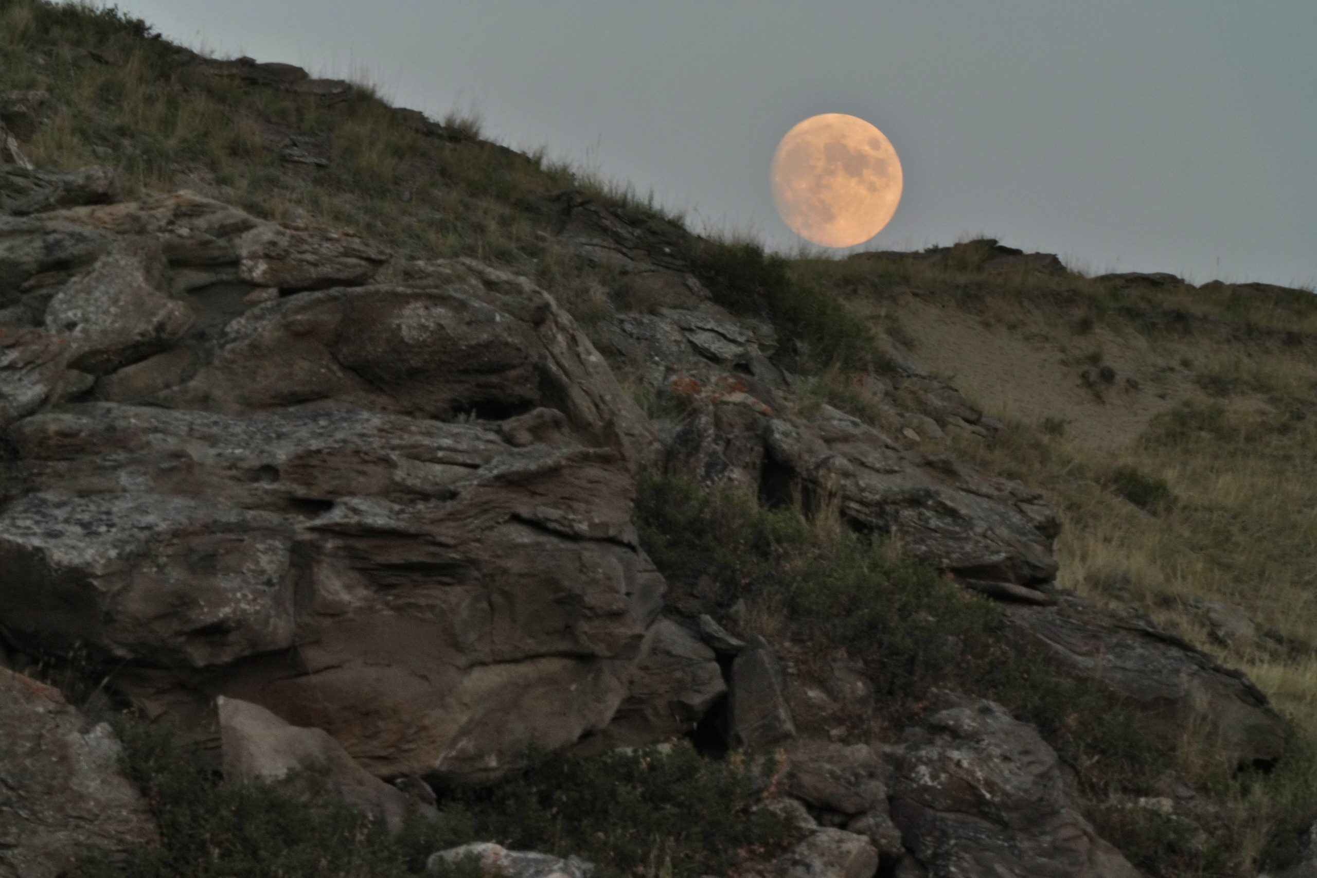 Moon Rising Rocky Cliff