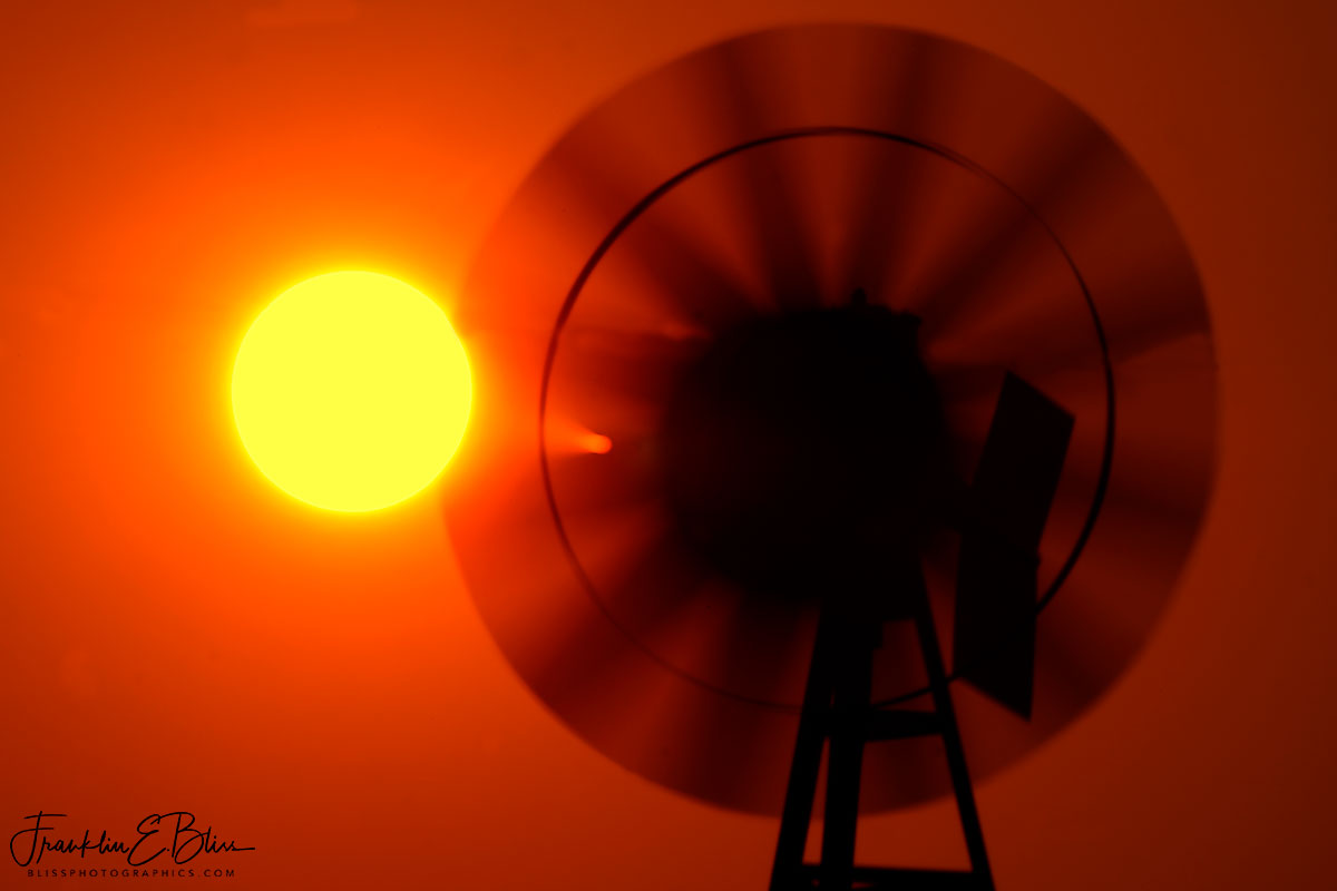Blurry Smokey Windmill Sunset